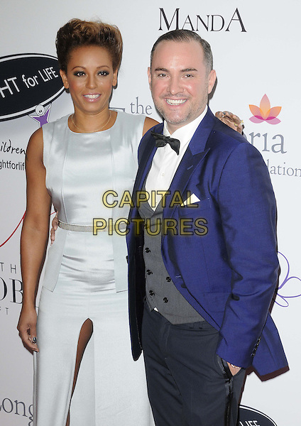 Melanie Brown ( Mel B ) & Nick Ede.attended the Noble Gift Gala, ME London, The Strand, London, England, UK, 8th December 2012..half length hand on hip white dress silver sleeveless slit split blue jacket bow tie tuxedo  .CAP/CAN.©Can Nguyen/Capital Pictures.