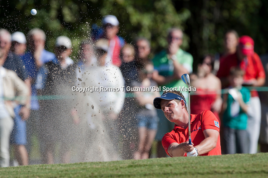 November 14, 2010: Luke Donald of England hits out off the green side bunker on the second hole of the Magnolia course during third round golf action from The Children's Miracle Network Hospitals Classic held at The Disney Golf Resort in Lake Buena Vista, FL.