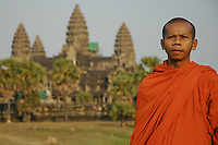 A monk in the grounds of Angkor Wat, Siem Reap province, Cambodia.