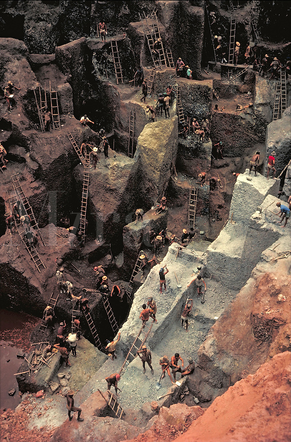 Aerial view of the ladders and terraces at a Brazilian gold mine. Men work with shovels and pickaxes. occupations, trades, mining, minerals, industry, geology. Brazil Serra Pelada.