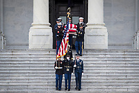 The flag-draped casket of former President George H. W. Bush is carried by a joint services military honor guard down the steps of the U.S. Capitol, Wednesday, Dec. 5, 2018, in Washington. (Sarah Silbiger/The New York Times via AP, Pool)<br /> <br /> CAP/MPI/RS<br /> &copy;RS/MPI/Capital Pictures