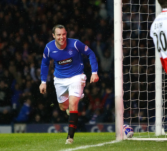 Kris Boyd wheels away after scoring goal no 2 past Robert Olejnik