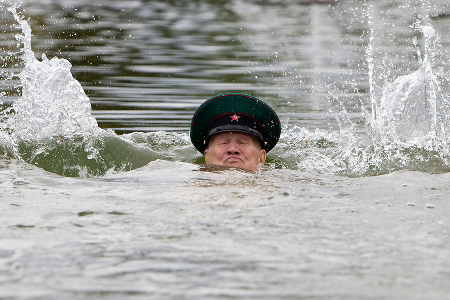 Moscow, Russia, 28/05/2010..A pensioner and former member of the Russian Border Troops dives in a lake in Gorky Park as the regiment celebrated their annual holiday..