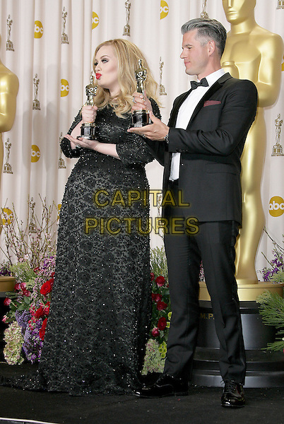 Adele (Adele Laurie Blue Adkins) & Paul Epworth.85th Annual Academy Awards held at the Dolby Theatre at Hollywood & Highland Center, Hollywood, California, USA..February 24th, 2013.pressroom oscars full length trophies winners black dress tuxedo white shirt  beads beaded  glasses award trophy winner profile kiss kissing puckering .CAP/ADM.©AdMedia/Capital Pictures.