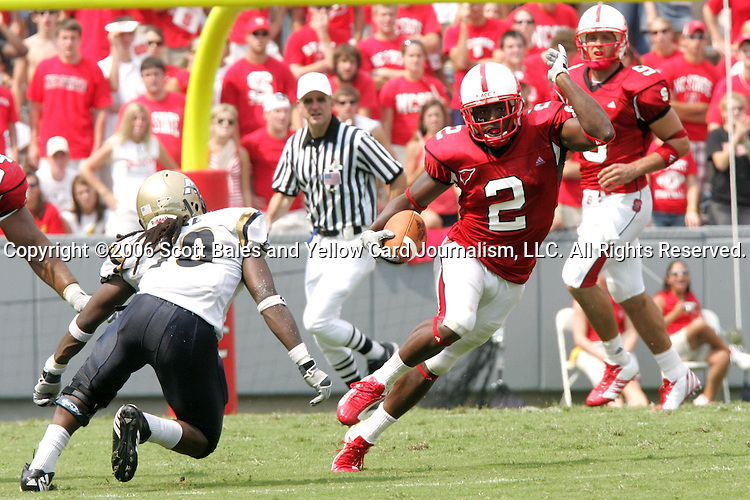 9 September 2006: North Carolina State's Darell Blackman (2) cuts inside against Akron's Chevin Pace (10). Akron defeated North Carolina State 20-17 at Carter-Finley Stadium in Raleigh, North Carolina in an NCAA college football game.