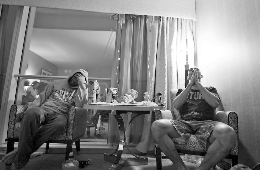 "George Sullivan (left) holds his head as Derrick ""DK"" Kennington says a prayer as they rehydrate themselves with fluids from I.V. bags after weighing in at the Borgata. Both men will be fighting in less than 24 hours."