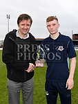 Marcus Cavaroli presents man of the match trophy to Drogheda United's Mark Doyle. Photo:Colin Bell/pressphotos.ie