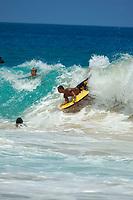 bodyboarders during large surf at Magic sands beach Kailua Kona The Big Island of Hawaii