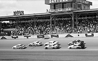 action pack of cars Ricky Rucc Cale yarborough Harry Gant David Pearson Daytona 500 at Daytona International Speedway in Daytona Beach, FL in February 1985. (Photo by Brian Cleary/www.bcpix.com) Daytona 500, Daytona International Speedway, Daytona Beach, FL, February 1985. (Photo by Brian Cleary/www.bcpix.com)