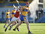 Peter Duggan of Clare scores a goal despite the apposition's5 Eoin Murphy during their Munster Hurling League game against Cork at Cusack Park. Photograph by John Kelly.