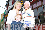HELPING: Yvonne OConnor from the Greyhound Bar, Prembroke Street, is pictured with Angela Cetnarsky and Shelby Cetnarsky (front) donating money towards The Dunmore East Trawler Tragedy Fund.