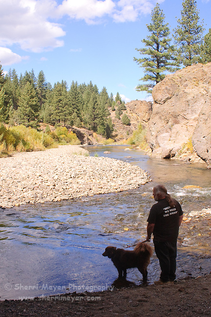 Man and dog enjoying the East Fork of the Carson River, near Markleeville, California