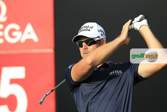 Henrik Stenson (SWE) tees off the par3 15th tee during Thursday's Round 1 of the Omega Dubai Desert Classic 2014 held at the Emirates Golf Club, Dubai. 30th January 2014.<br /> Picture: Eoin Clarke www.golffile.ie