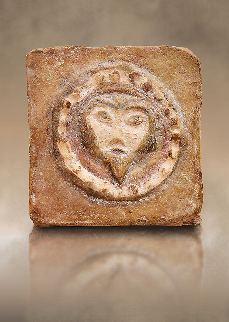6th-7th Century Eastern Roman Byzantine  Christian Terracotta tiles depicting Christ - Produced in Byzacena -  present day Tunisia. <br /> <br /> These early Christian terracotta tiles were mass produced thanks to moulds. Their quadrangular, square or rectangular shape as well as the standardised sizes in use in the different regions were determined by their architectonic function and were designed to facilitate their assembly according to various combinations to decorate large flat surfaces of walls or ceilings. <br /> <br /> Byzacena stood out for its use of biblical and hagiographic themes and a richer variety of animals, birds and roses. Some deer and lions were obviously inspired from Zeugitana prototypes attesting to the pre-existence of this province's production with respect to that of Byzacena. The rules governing this art are similar to those that applied to late Roman and Christian art with, in the case of Byzacena, an obvious popular connotation. Its distinguishing features are flatness, a predilection for symmetrical compositions, frontal and lateral representations, the absence of tridimensional attitudes and the naivety of some details (large eyes, pointed chins). Mass production enabled this type of decoration to be widely used at little cost and it played a role as ideograms and for teaching catechism through pictures. Painting, now often faded, enhanced motifs in relief or enriched them with additional details to break their repetitive monotony.<br /> <br /> The Bardo National Museum Tunis, Tunisia