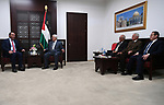Palestinian President Mahmoud Abbas meets with meets with Grand Mayor of Amman Yousef Al-Shawarbeh, at his headquarters in the West Bank city of Ramallah on November 24, 2017. Photo by Osama Falah