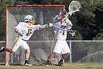 Palos Verdes, CA 03/30/10 - Michael Gurunlian (Peninsula #1) and Kyle Uraguchi (Peninsula #16) in action during the Palos Verdes-Peninsula Varsity CIF Boys lacrosse game at Peninsula HS.