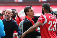 Gary Neville congratulates Nathan Pond on the pitch after the final whistle as Salford City celebrate their victory during AFC Fylde vs Salford City, Vanarama National League Football Promotion Final at Wembley Stadium on 11th May 2019