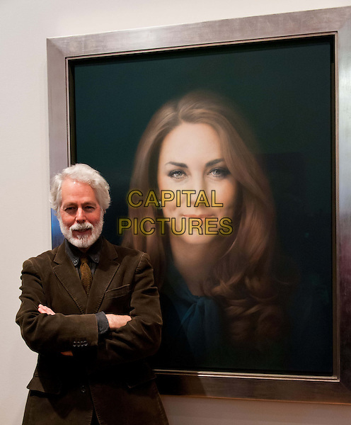 Paul Emsley with his portrait of Catherine, Duchess of Cambridge.National Portrait Gallery commissions first official painted portrait of The Duchess of Cambridge, where it was unveiled today.  The Duchess was involved in the selection process, from which artist Paul Emsley, the 2007 winner of the Gallery's BP Portrait Award competition, was chosen by Director Sandy Nairne to paint her official portrait.  National Portrait Gallery, St Martin's Place, London, United Kingdom.  .11th January 2013..painting art artwork portrait headshot kate middleton catherine cameras press half length artist arms crossed folded brown jacket tie  .CAP/BF.©Bob Fidgeon/Capital Pictures.