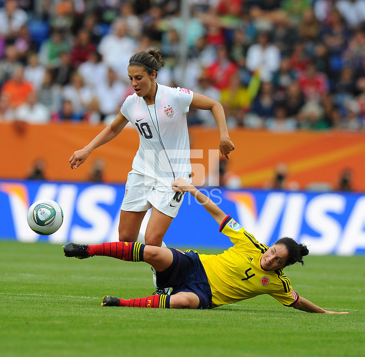 Carli Lloyd (l) of team USA and Diana Ospina of team Colombia during the FIFA Women's World Cup at the FIFA Stadium in Sinsheim, Germany on July 2nd, 2011.