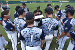 02 June 2016: Nova Southeastern assistant coach Eric Cruz (center) gives his team a scouting report before the game. The Nova Southeastern University Sharks played the Cal Poly Pomona Broncos in Game 11 of the 2016 NCAA Division II College World Series  at Coleman Field at the USA Baseball National Training Complex in Cary, North Carolina. Nova Southeastern won the semifinal game 4-1 and advanced to the championship series.