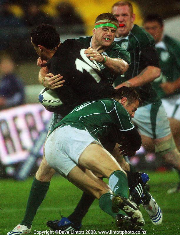 Jamie Heaslip and Tommy Bowe tackle Dan Carter. International Test Match - All Blacks v Ireland, Westpac Stadium, Wellington. Saturday 7 June 2008. Photo: Dave Lintott / lintottphoto.co.nz