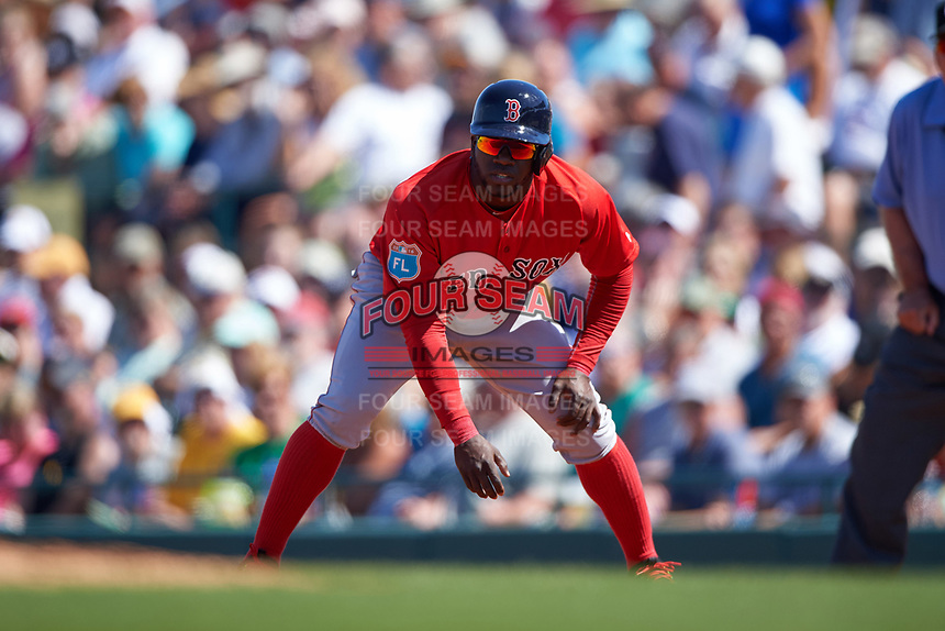 Boston Red Sox center fielder Rusney Castillo (38) leads off first base during a Spring Training game against the Pittsburgh Pirates on March 9, 2016 at McKechnie Field in Bradenton, Florida.  Boston defeated Pittsburgh 6-2.  (Mike Janes/Four Seam Images)