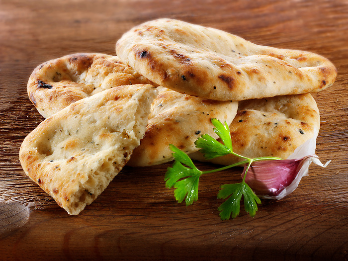 Garlic and coriander Indian Naan Bread food stock pictures, photos fotos & images