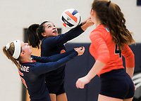 NWA Democrat-Gazette/CHARLIE KAIJO Rogers Heritage High School Berenice Morales (2) and Josie Stitt (5) dig during a volleyball game, Thursday, October 11, 2018 at Rogers Heritage High School in Rogers.