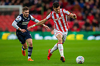 11th January 2020; Bet365 Stadium, Stoke, Staffordshire, England; English Championship Football, Stoke City versus Milwall FC; Danny Batth of Stoke City under pressure from Tom Bradshaw of Millwall - Strictly Editorial Use Only. No use with unauthorized audio, video, data, fixture lists, club/league logos or 'live' services. Online in-match use limited to 120 images, no video emulation. No use in betting, games or single club/league/player publications