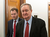 United States Senator Mike Crapo (Republican of Idaho), right, walks in the hallway during a break in the testimony before the United States Senate Committee on the Judiciary as Judge Brett Kavanaugh attempts to refute the testimony of Dr. Christine Blasey Ford on his nomination to be Associate Justice of the US Supreme Court to replace the retiring Justice Anthony Kennedy on Capitol Hill in Washington, DC on Thursday, September 27, 2018.<br /> Credit: Ron Sachs / CNP<br /> (RESTRICTION: NO New York or New Jersey Newspapers or newspapers within a 75 mile radius of New York City)