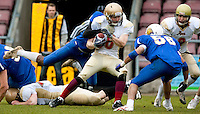 09 MAY 2010 - NORTHAMPTON, GBR - Loughborough Aces (white and gold) vs. Birmingham Lions (blue) - British Universities American Football Championship Final (PHOTO (C) NIGEL FARROW)