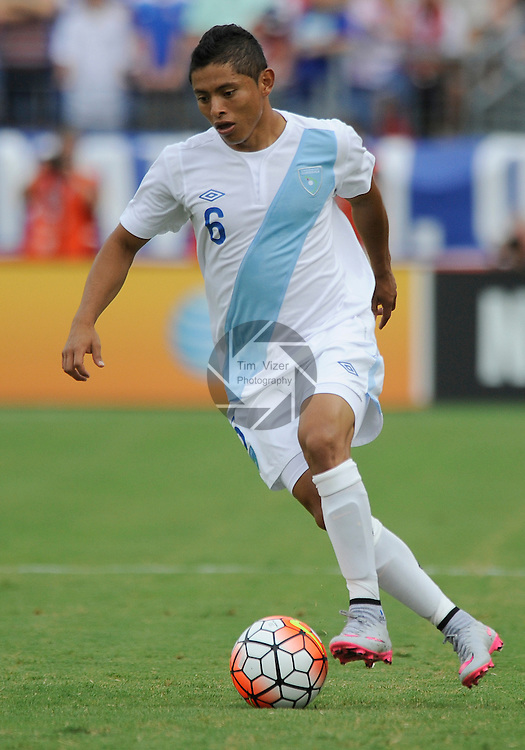 Guatemala midfielder Carlos Mejia (6) brings the ball downfield in the first half. Guatemala played the USA Men's National Team in an International Friendly soccer game on Friday July 3, 2015 at Nissan Stadium in Nashville, Tennessee. The USA won, 4-0.