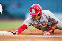 Houston Cougars outfielder Kyle Survance #34 dives back to first base against the Baylor Bears in the NCAA baseball game on March 2, 2013 at Minute Maid Park in Houston, Texas. Houston defeated Baylor 15-4. (Andrew Woolley/Four Seam Images).
