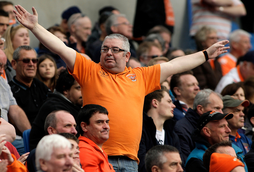A Blackpool fan holds his arms out as he cheers on his team.<br /> <br /> Photo by James Marsh/CameraSport<br /> <br /> Football - The Football League Sky Bet Championship - Brighton and Hove Albion v Blackpool - Monday 21st April 2014 - American Express Community Stadium - Brighton<br /> <br /> &copy; CameraSport - 43 Linden Ave. Countesthorpe. Leicester. England. LE8 5PG - Tel: +44 (0) 116 277 4147 - admin@camerasport.com - www.camerasport.com