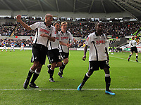 ATTENTION SPORTS PICTURE DESK<br /> Pictured: Nathan Dyer of Swansea (R) celebrating his goal with team mates L-R Darren Pratley, Leon Britton and Cedric Van Dre Gun.<br /> Re: Coca Cola Championship, Swansea City Football Club v Cardiff City FC at the Liberty Stadium, Swansea, south Wales. Saturday 07 November 2009