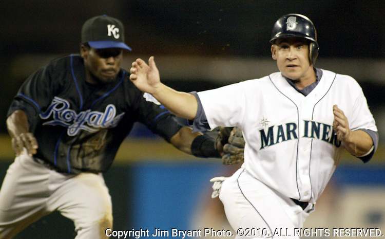 Seattle Mariners' Bret Boone is run down by Kansas City Royals' shortstop Angel Berroa after being caught in a pickle  in the sixth  inning of their game at Safeco Field in Seattle, Washington on Thursday, 26 August 2004.  Jim Bryant Photo. ©2010. ALL RIGHTS RESERVED.
