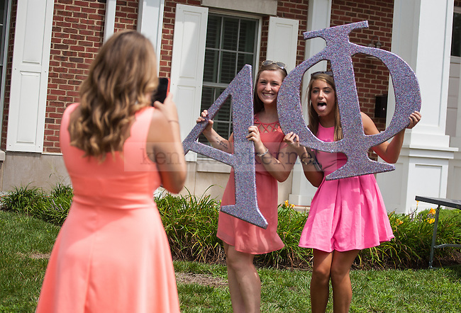 Alpha Phi sophomores Hadley Gordon (left) and Emily Wilson pose for a picture during UK's sorority bid day in Lexington, Ky., on Friday, August 22, 2014. Photo by Adam Pennavaria | Staff