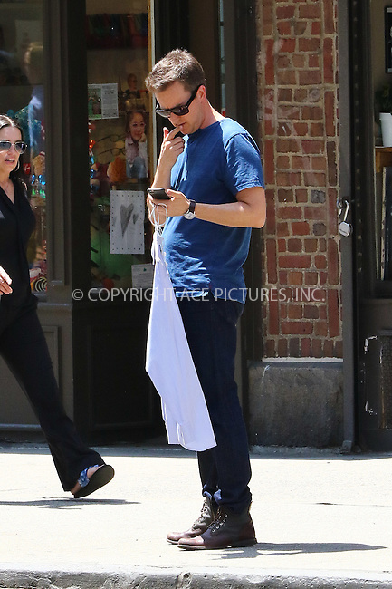 WWW.ACEPIXS.COM<br /> <br /> May 26 2016, New York City<br /> <br /> Actor Ed Norton checks his cellphone as he picks up his dry cleaning on May 26 2016 in New York City<br /> <br /> By Line: Zelig Shaul/ACE Pictures<br /> <br /> <br /> ACE Pictures, Inc.<br /> tel: 646 769 0430<br /> Email: info@acepixs.com<br /> www.acepixs.com
