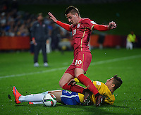 Brazil's Joao Pedro tackles Sergej Milinkovic during the FIFA Under-20 Football World Cup Final between Brazil (gold) and Serbia at North Harbour Stadium, Albany, New Zealand on Saturday, 20 June 2015. Photo: Dave Lintott / lintottphoto.co.nz