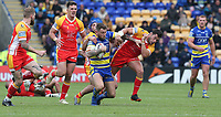 Warrington Wolves' Daryl Clark is tackled by Catalans Dragons' Benjamin Garcia (right) and Benjamin Jullien <br /> <br /> Photographer Stephen White/CameraSport<br /> <br /> Betfred Super League Round 17 - Warrington Wolves v Catalans Dragons - Saturday 8th June 2019 - Halliwell Jones Stadium - Warrington<br /> <br /> World Copyright © 2019 CameraSport. All rights reserved. 43 Linden Ave. Countesthorpe. Leicester. England. LE8 5PG - Tel: +44 (0) 116 277 4147 - admin@camerasport.com - www.camerasport.com