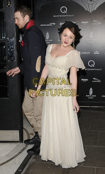 TOM BEARD & JAIME WINSTONE .The Quintessentially 10th anniversary party, Savoy hotel, London, England..December 13th, 2010.full length black dress white maxi beads beaded jamie grey gray coat couple holding hands side profile .CAP/CAN.©Can Nguyen/Capital Pictures.