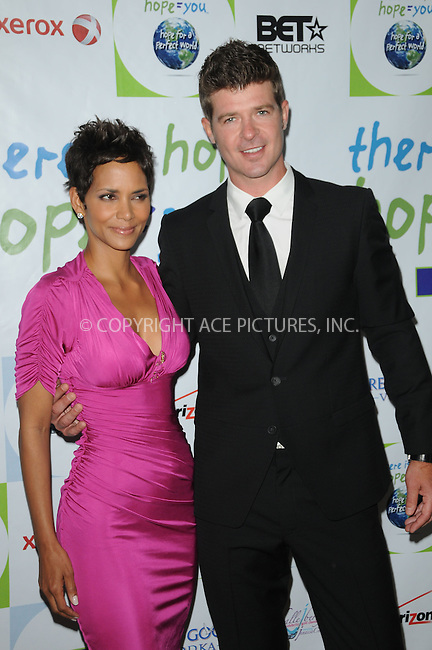 WWW.ACEPIXS.COM . . . . . ....April 17 2011, Los Angeles....Actress Halle Berry and Recording artist Robin Thicke arriving at the 2011 Jenesse Silver Rose Auction and Gala at the Beverly Hills Hotel on April 17, 2011 in Beverly Hills, CA....Please byline: PETER WEST - ACEPIXS.COM....Ace Pictures, Inc:  ..(212) 243-8787 or (646) 679 0430..e-mail: picturedesk@acepixs.com..web: http://www.acepixs.com