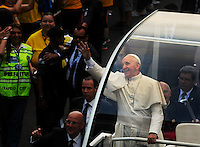 Pope Francis waves from his popemobile as he makes his way from Cathedral to downtown of Rio de Janeiro, Brazil, July 22, 2013. The pontiff arrived for a seven-day visit in Brazil and to participate at church's World Youth Day festival meeting legions of young Roman Catholics. (Austral Foto/Renzo Gostoli)