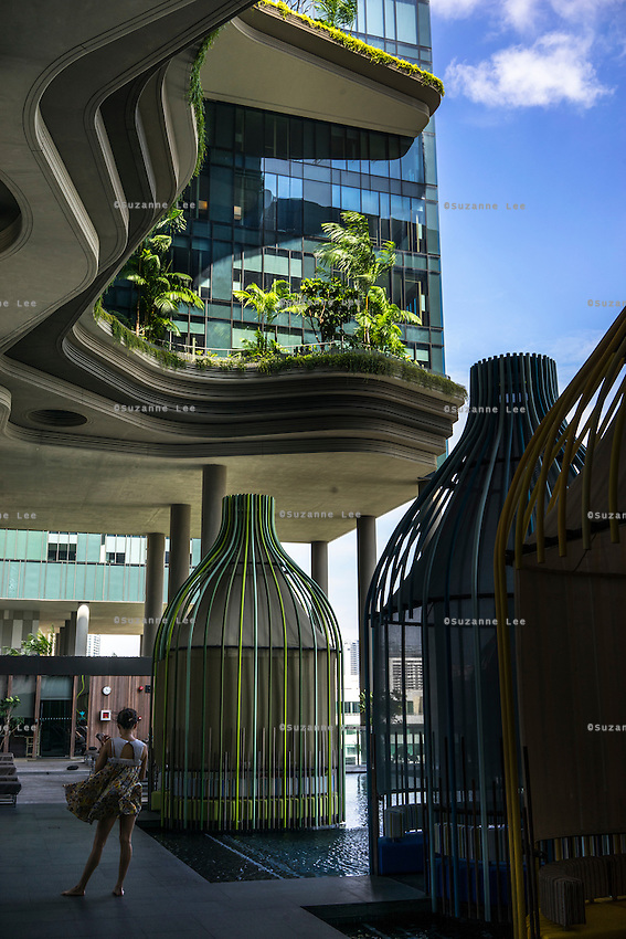 A part of the 300-meter-long garden strip on the fifth floor of the Parkroyal hotel which claims to have a total foliage cover that constitutes more than 200% of the structure&rsquo;s total land area, effectively using vertical greenery to replace the original greenery that was lost to build the hotel. The 12-storey-high tower features massive curvaceous, solar-powered sky-gardens which overlook the city park in the central business district of Singapore.<br />  Photo by Suzanne Lee/Panos Pictures
