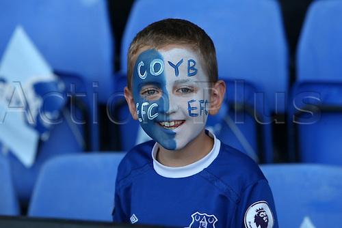 17.09.2016. Goodison Park, Liverpool, England. Premier League Football. Everton versus Middlesbrough. A young fan anticipates the kick off.