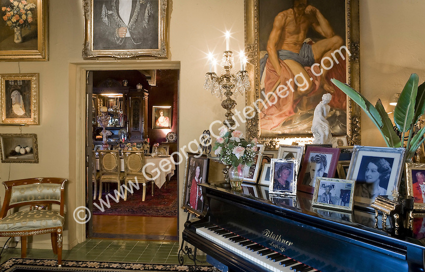 Liberace Palm Springs house with grand piano and art