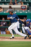 Lakeland Flying Tigers center fielder Jose Azocar (10) follows through on a swing during the first game of a doubleheader against the St. Lucie Mets on June 10, 2017 at Joker Marchant Stadium in Lakeland, Florida.  Lakeland defeated St. Lucie 6-5 in fourteen innings.  (Mike Janes/Four Seam Images)