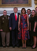 United States President Donald J. Trump and First lady Melania Trump participates in a photo op with senior military leaders and their spouses in the State Dining Room of the White House in Washington, DC on Monday, October 7, 2019.  Pictured from left to right: United States Army General Mark A. Milley, Chairman of the Joint Chiefs of Staff, President Trump, First lady Melania Trump, United States Secretary of Defense Dr. Mark T. Esper, and Leah Esper, wife of Secretary Esper.<br /> Credit: Ron Sachs / Pool via CNP