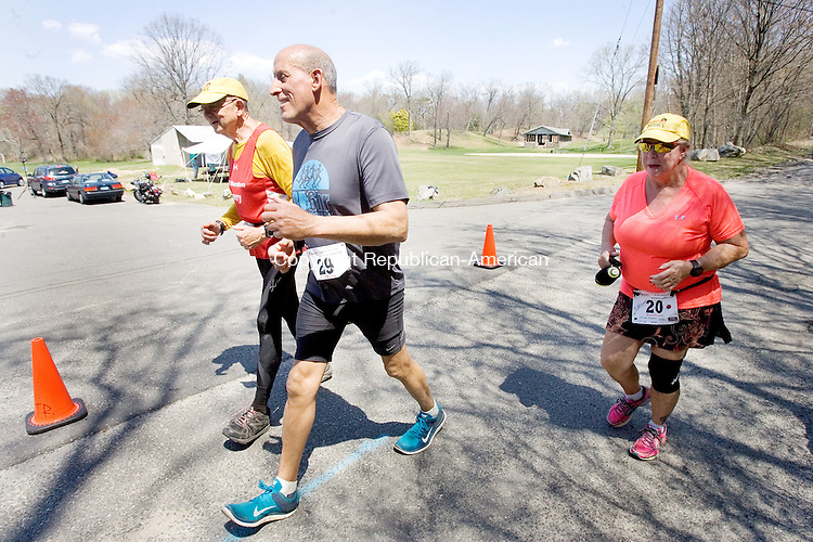 WATREBURY CT. 04 May 2015-050415SV06-From left, Larry Macon of San Antonio, TX., Ed Peters of Norwalk, and Kathleen Gorman of Phoenix AZ. run the Oh Boy Marathon in Hamilton Park in Waterbury Monday. <br /> Steven Valenti Republican-American