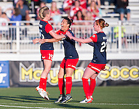 Boyds, MD - April 16, 2016: Washington Spirit midfielder Joanna Lohman (15) celebrates scoring with Washington Spirit defender Ali Krieger (11) and Washington Spirit defender Victoria Huster (23). The Washington Spirit defeated the Boston Breakers 1-0 during their National Women's Soccer League (NWSL) match at the Maryland SoccerPlex.